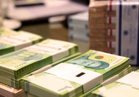 Iran to cut zeros and rename its currency